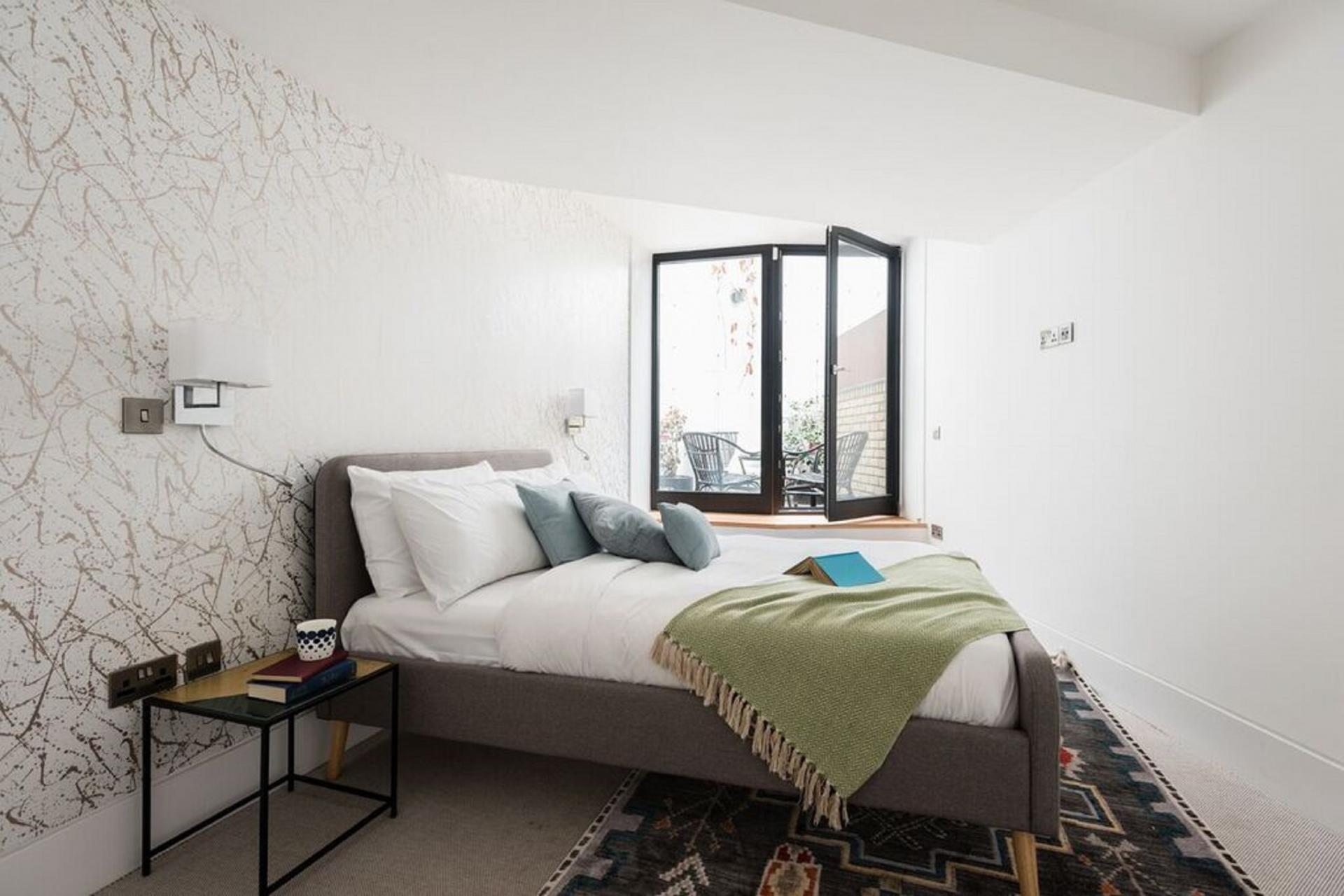 Bright bedroom at The Camden Chalet, Camden, London - Citybase Apartments