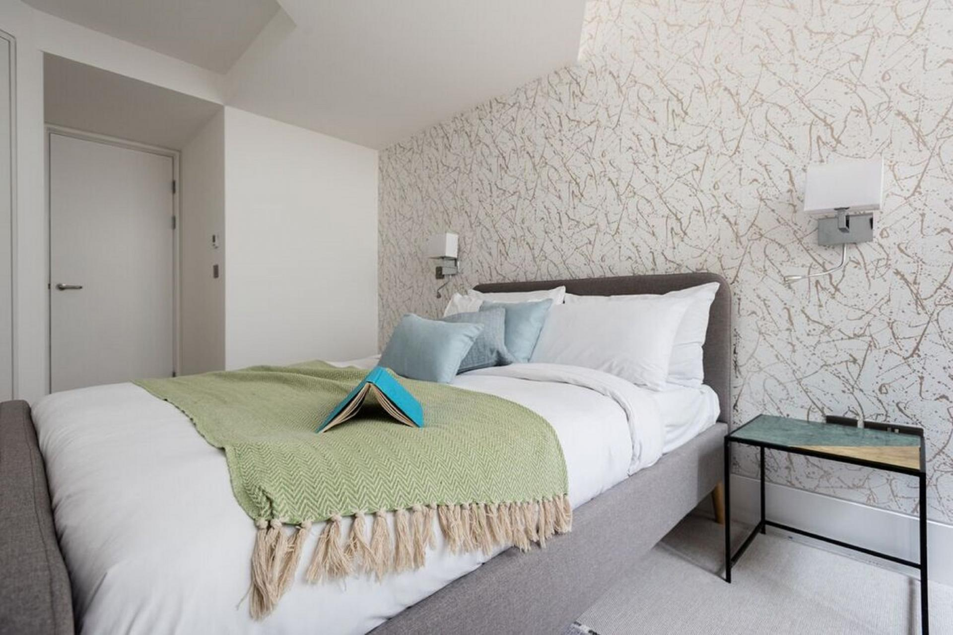 Double bed at The Camden Chalet, Camden, London - Citybase Apartments