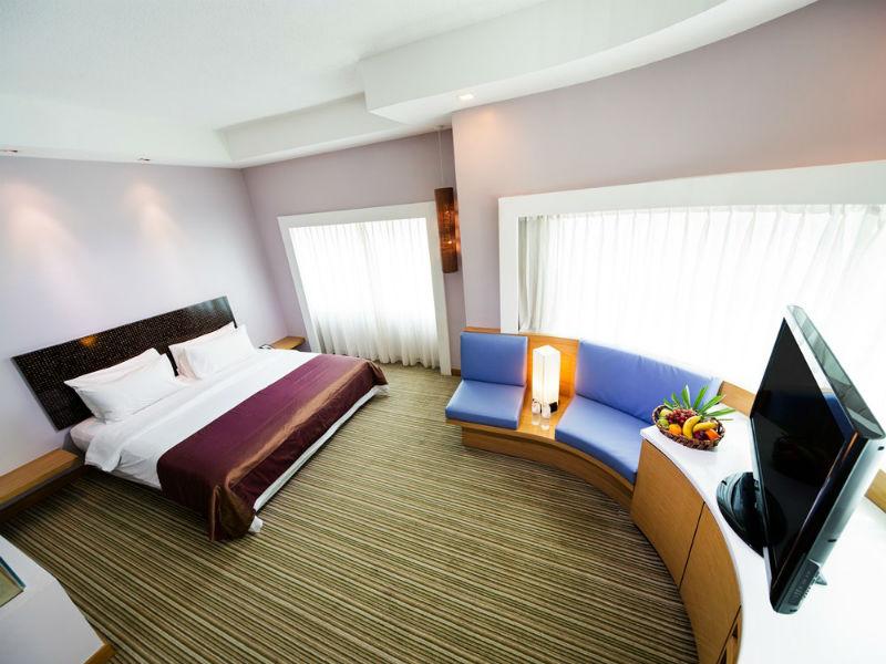 Bed at Village Hotel Changi, Loyang, Singapore - Citybase Apartments