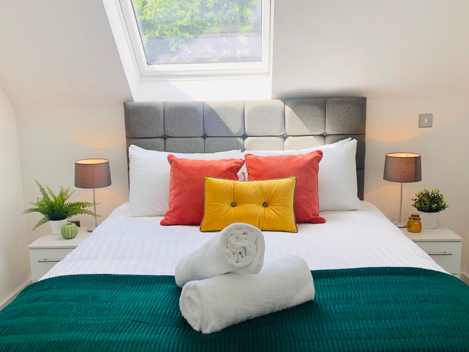 Bed at Opulent Luxe Apartments - Citybase Apartments