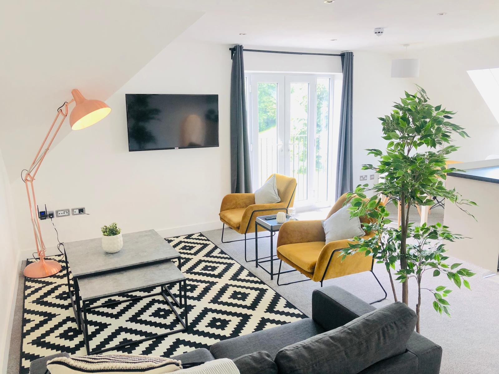 Living area at Opulent Luxe Apartments - Citybase Apartments