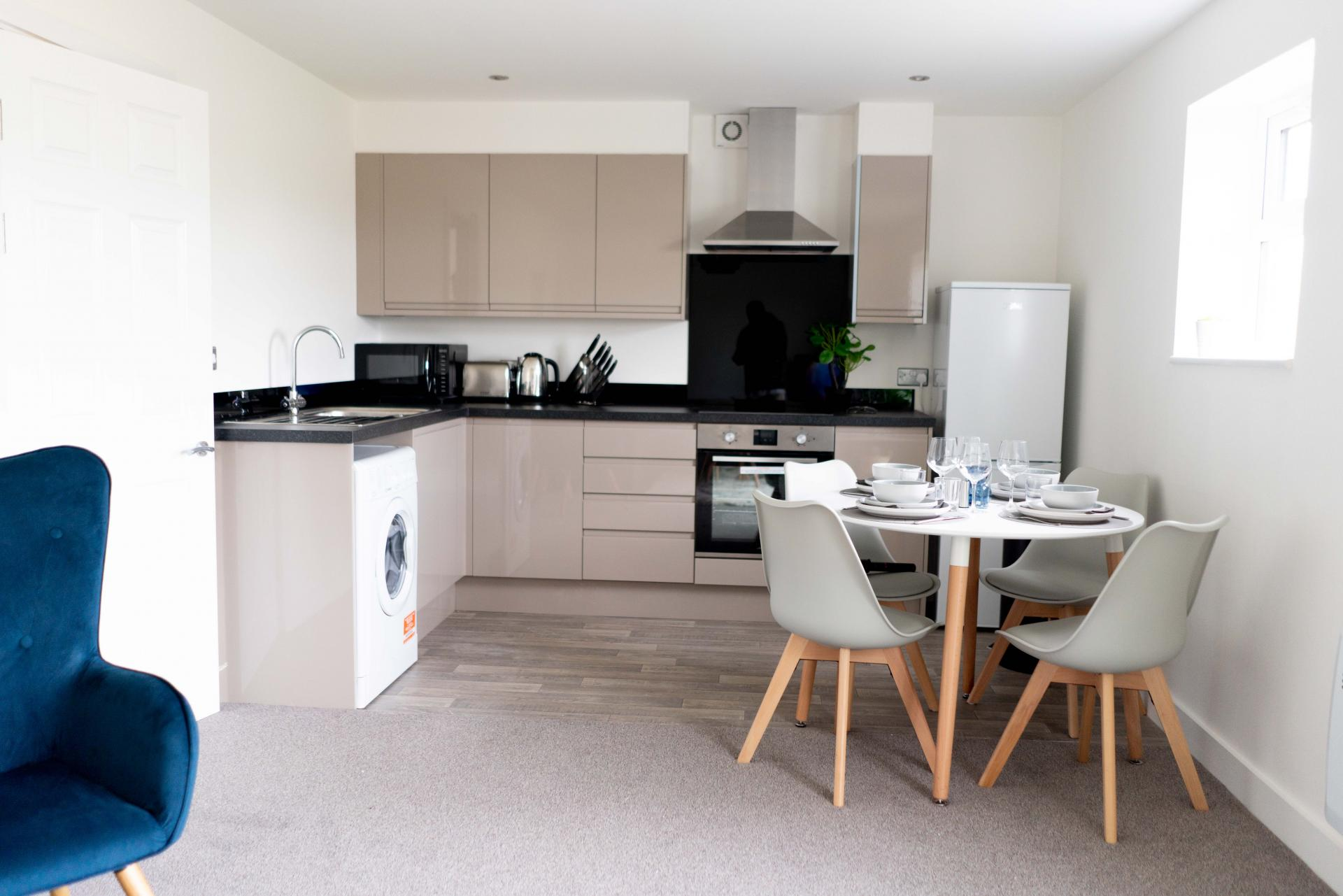 Kitchen area at Opulent Luxe Apartments - Citybase Apartments