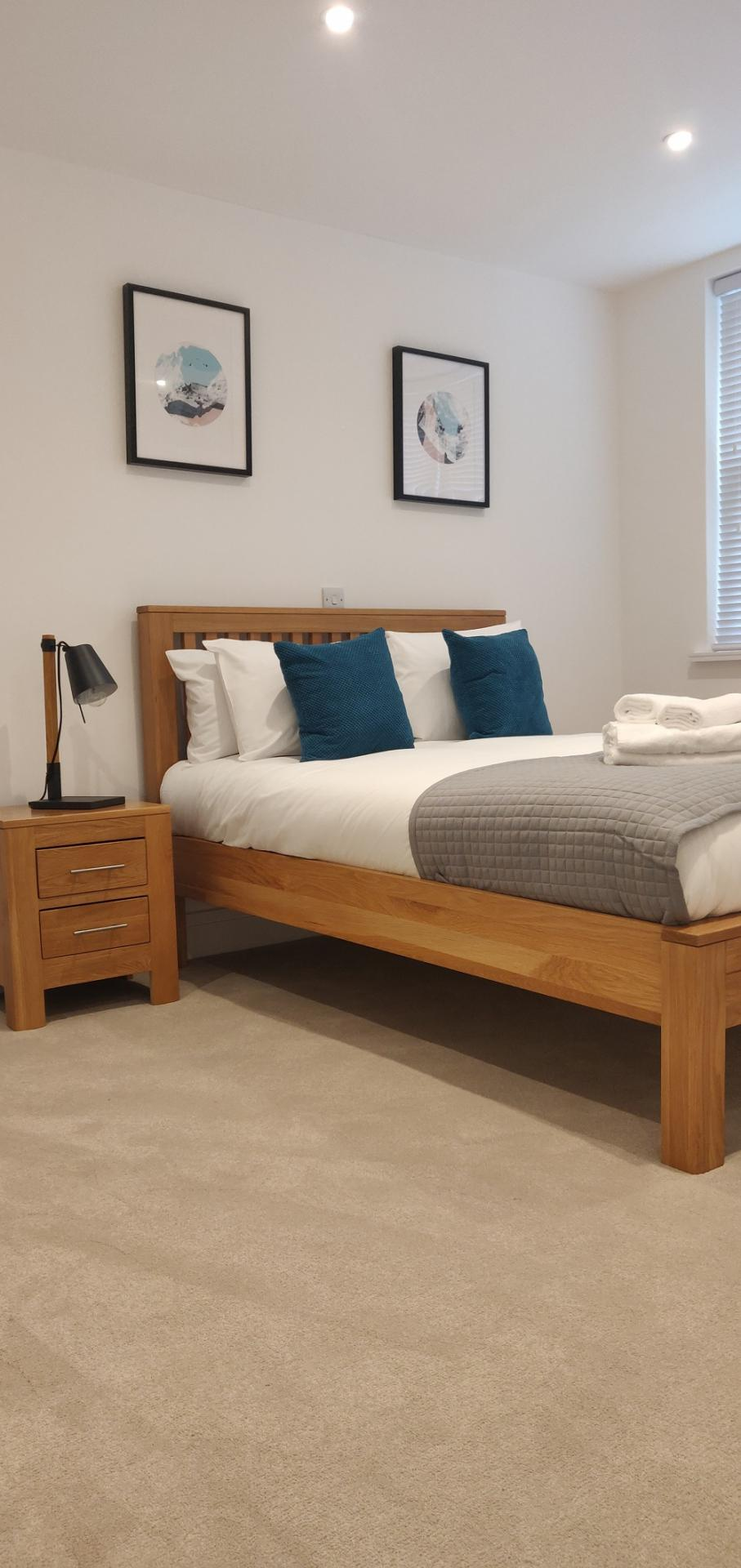 Bed at Flying Butler Bloomburg Street Apartments - Citybase Apartments