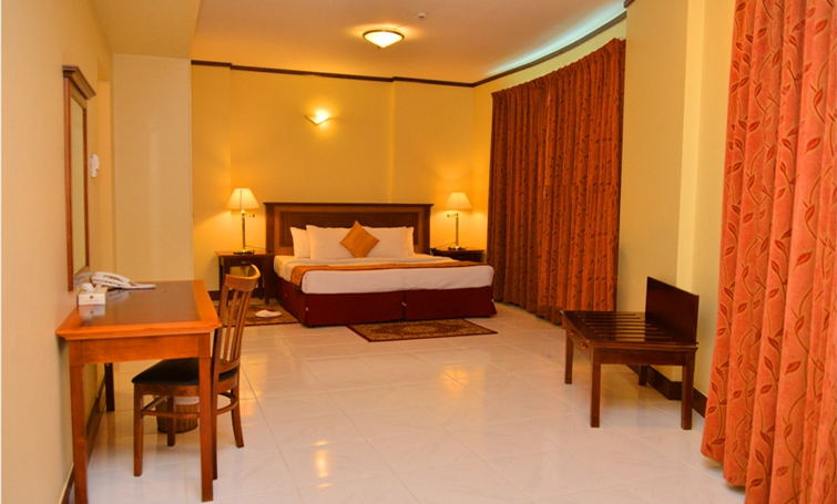 Bed at Desert Rose Hotel Apartments - Citybase Apartments
