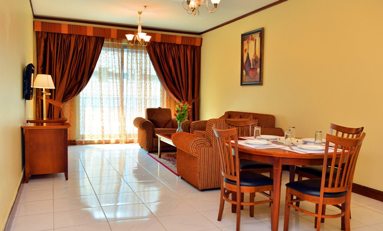 Living room at Desert Rose Hotel Apartments - Citybase Apartments