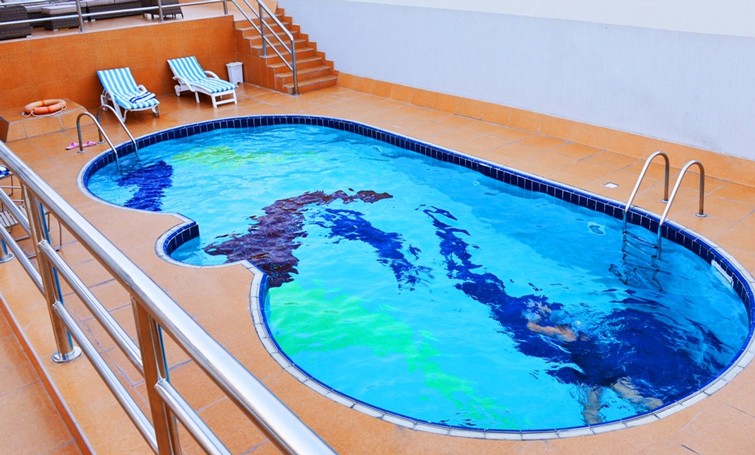 Swimming pool at Desert Rose Hotel Apartments - Citybase Apartments