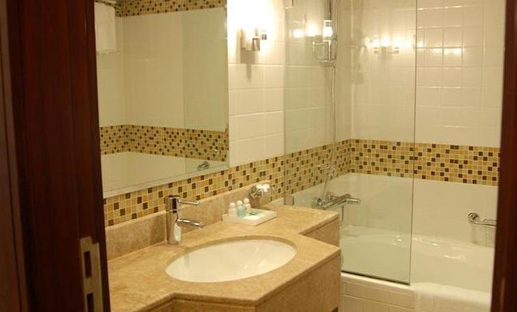 Bathroom at Desert Rose Hotel Apartments - Citybase Apartments