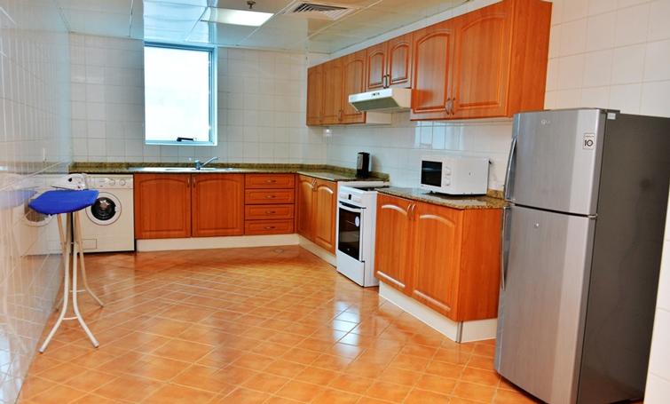 Kitchen at Desert Rose Hotel Apartments - Citybase Apartments