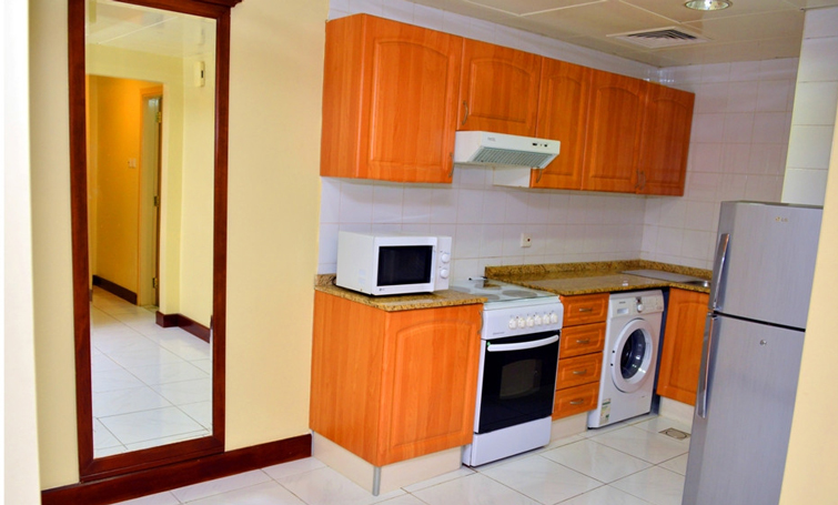 Washing machine at Desert Rose Hotel Apartments - Citybase Apartments