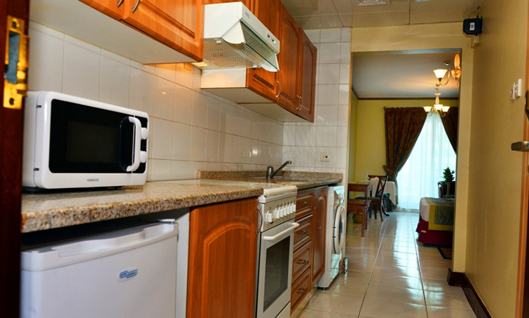 Microwave at Desert Rose Hotel Apartments - Citybase Apartments