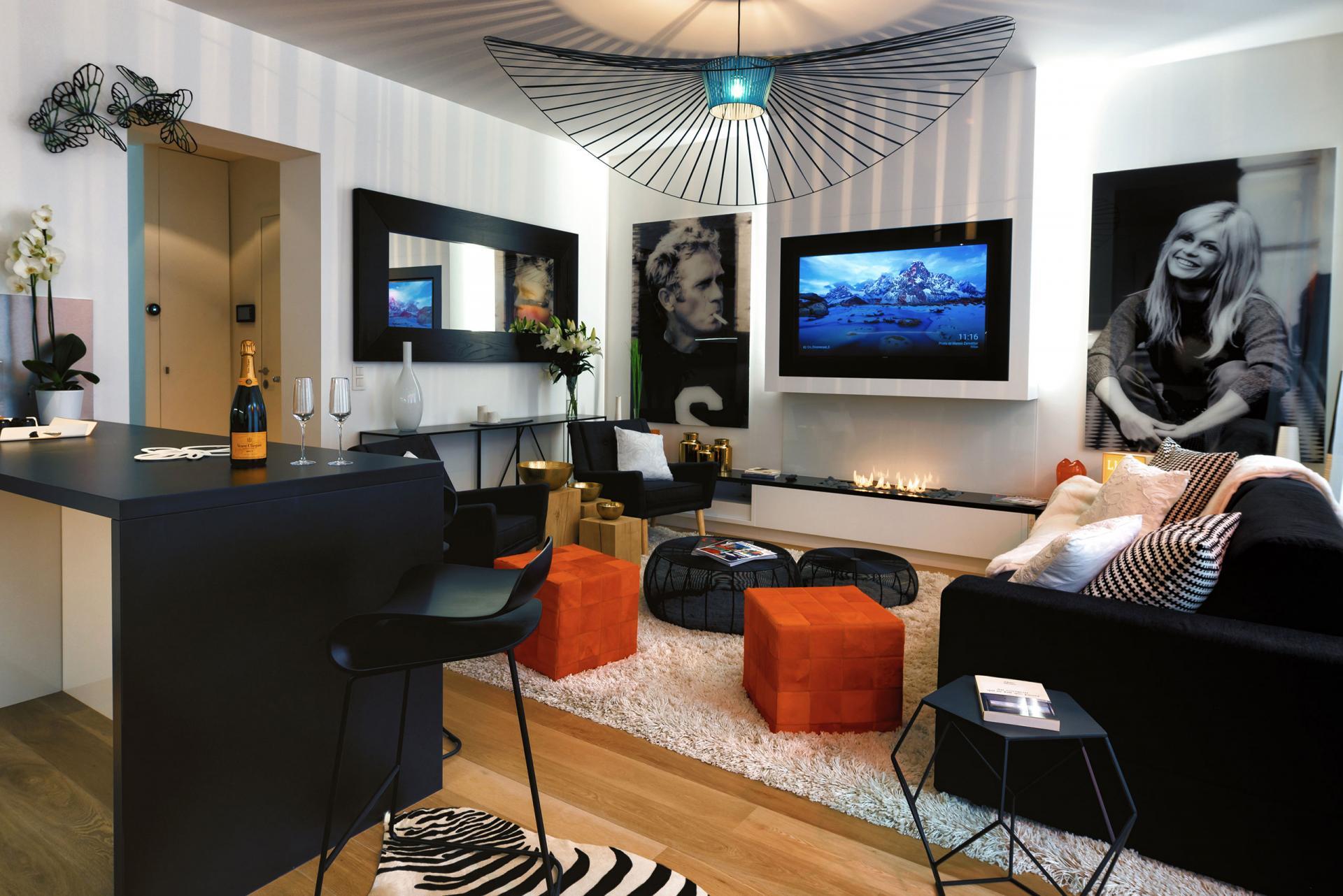 Living room orange at Amazone Charles Apartments - Citybase Apartments