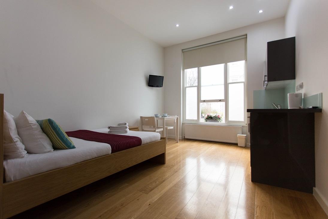 Bright bedroom at  Ladbroke Studios and Apartments - Citybase Apartments