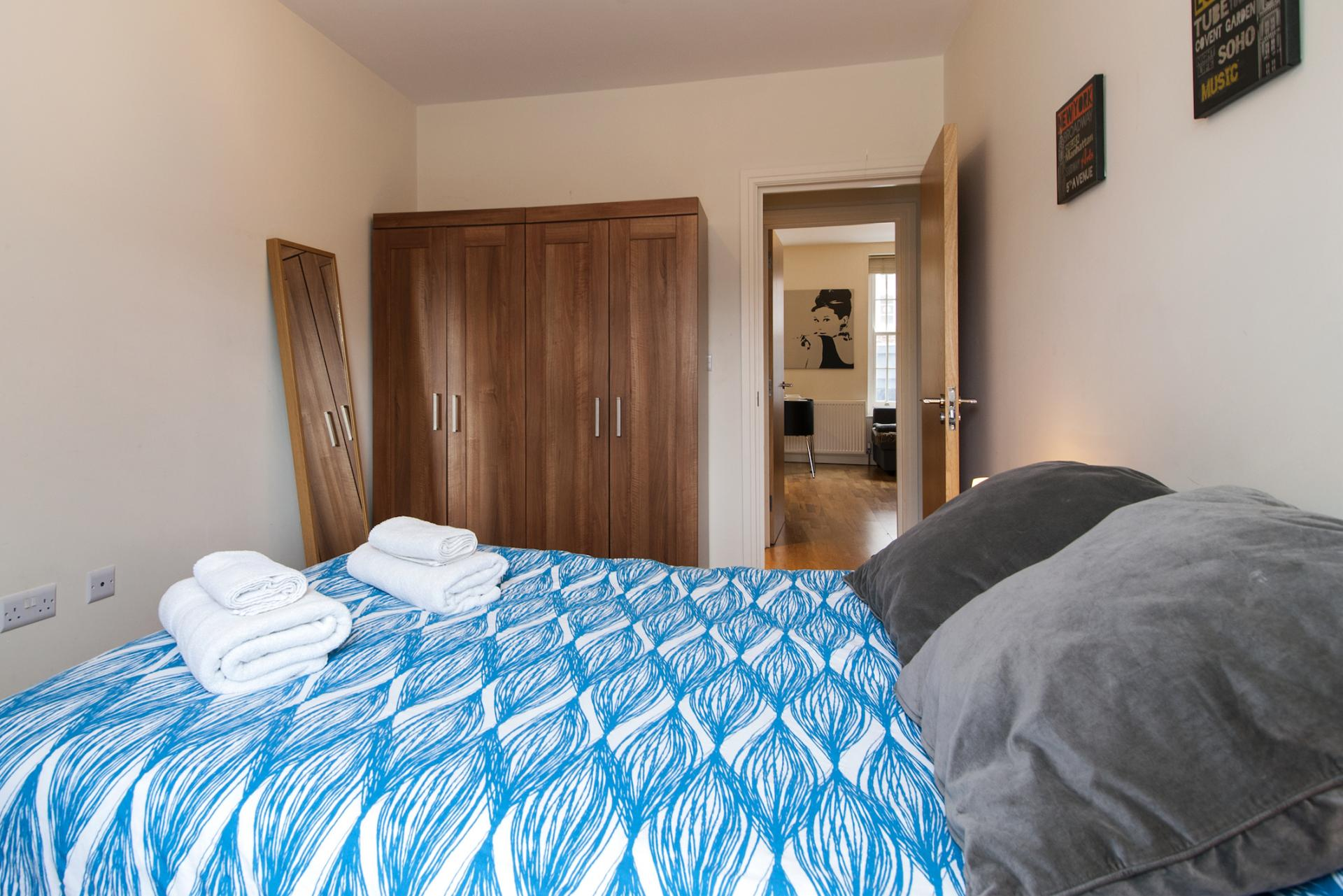 Blue bedroom at Angel Serviced Apartments - Citybase Apartments