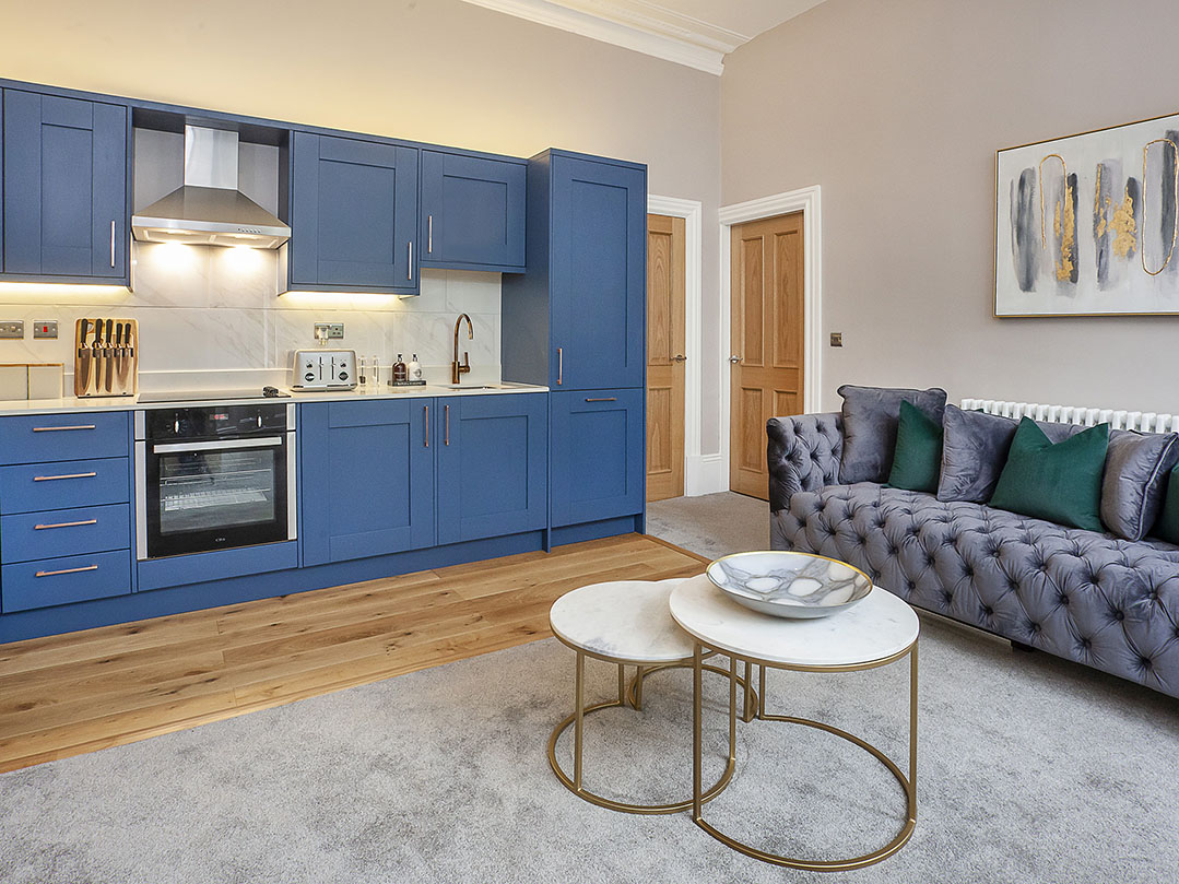 Blue kitchen at Bootham Luxury Apartments - Citybase Apartments
