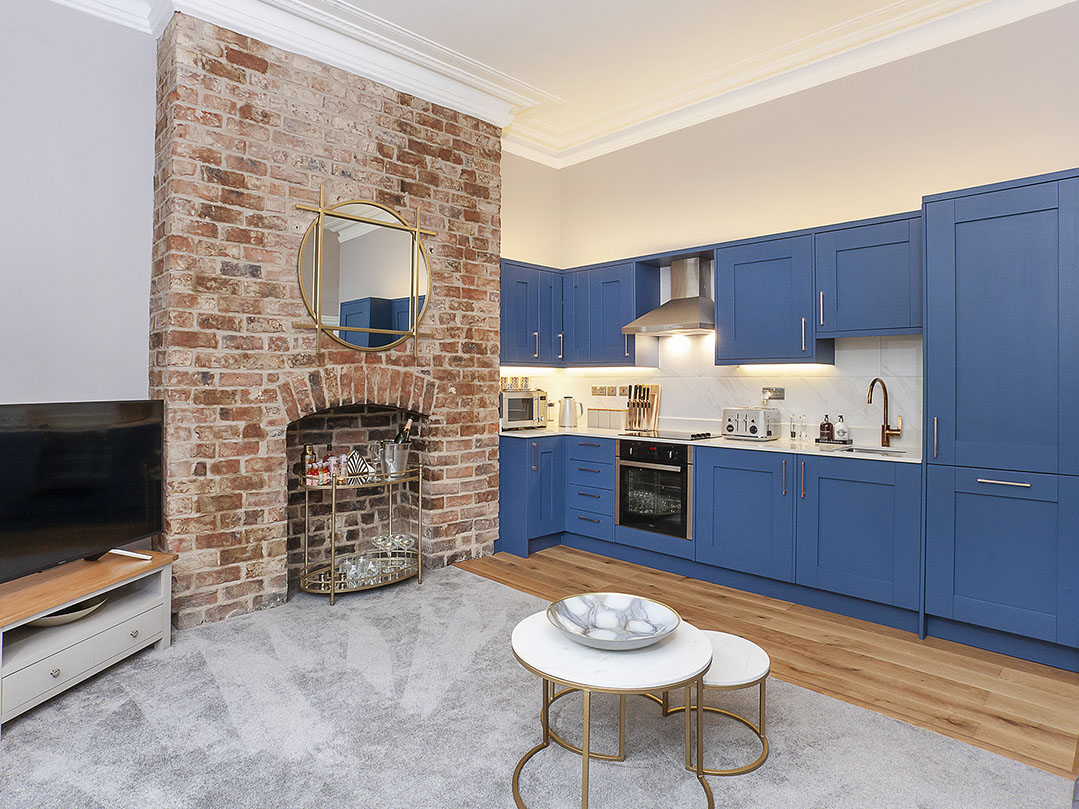 Exposed brick fireplace at Bootham Luxury Apartments - Citybase Apartments