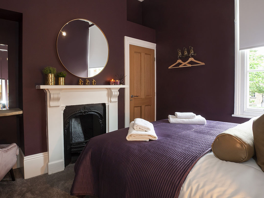 Bedroom fireplace at Bootham Luxury Apartments - Citybase Apartments
