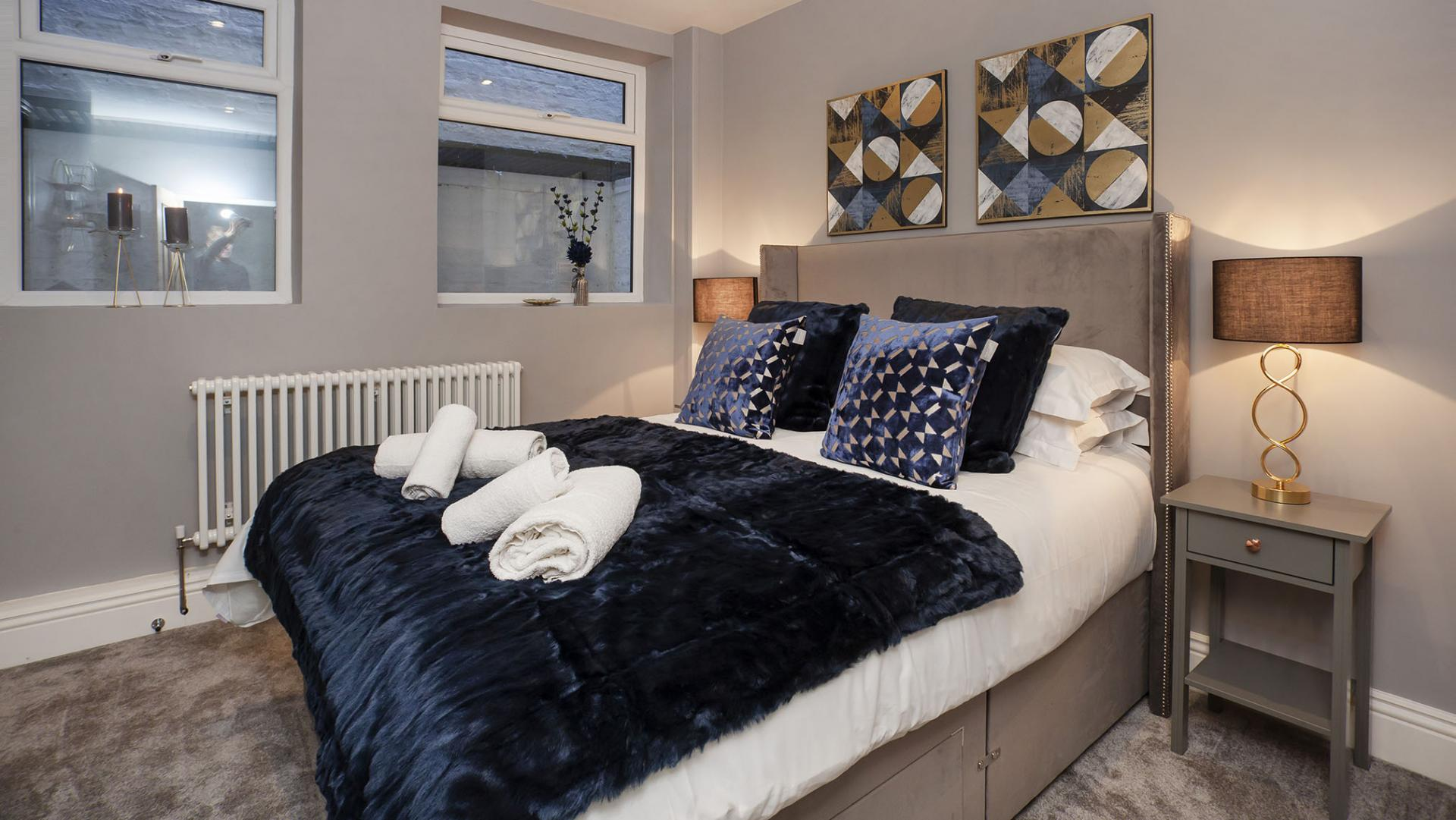Comfy bedspread at Bootham Luxury Apartments - Citybase Apartments