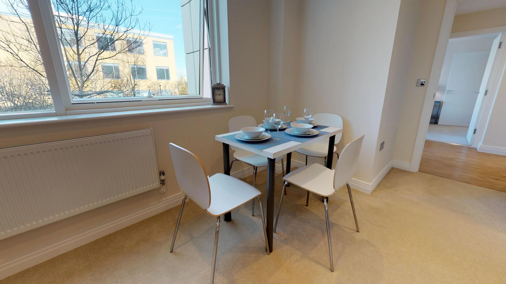 Dining room at Empire House Apartments - Citybase Apartments