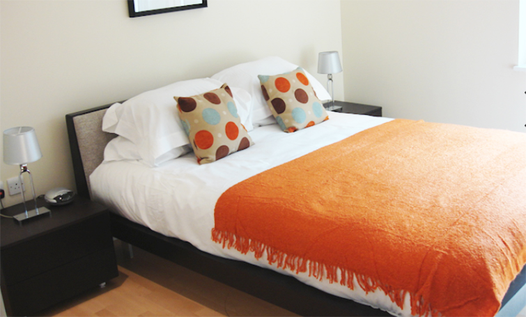 Bed at Sir John Lyon House Apartments - Citybase Apartments