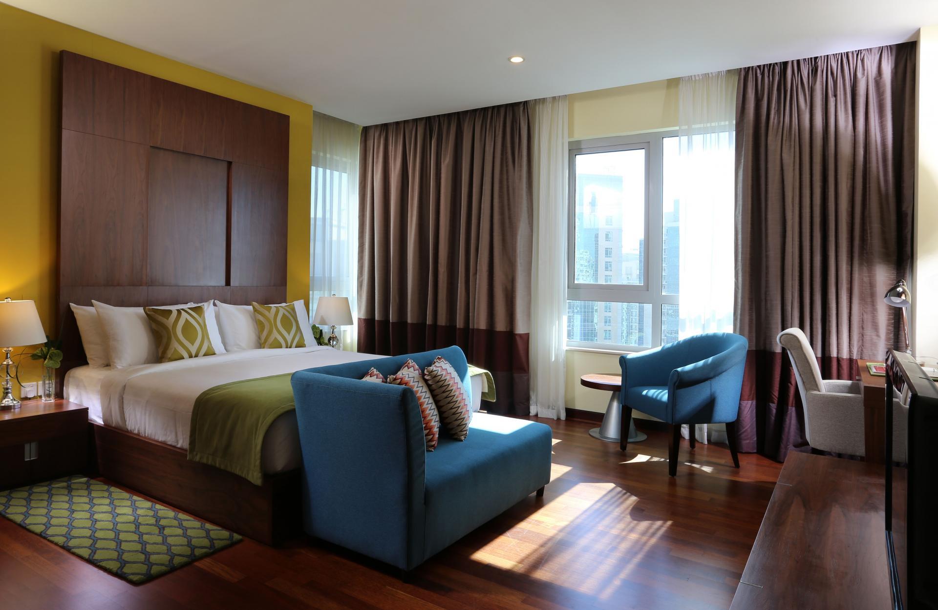 Spacious bedroom at Ramada Downtown Dubai Apartments - Citybase Apartments