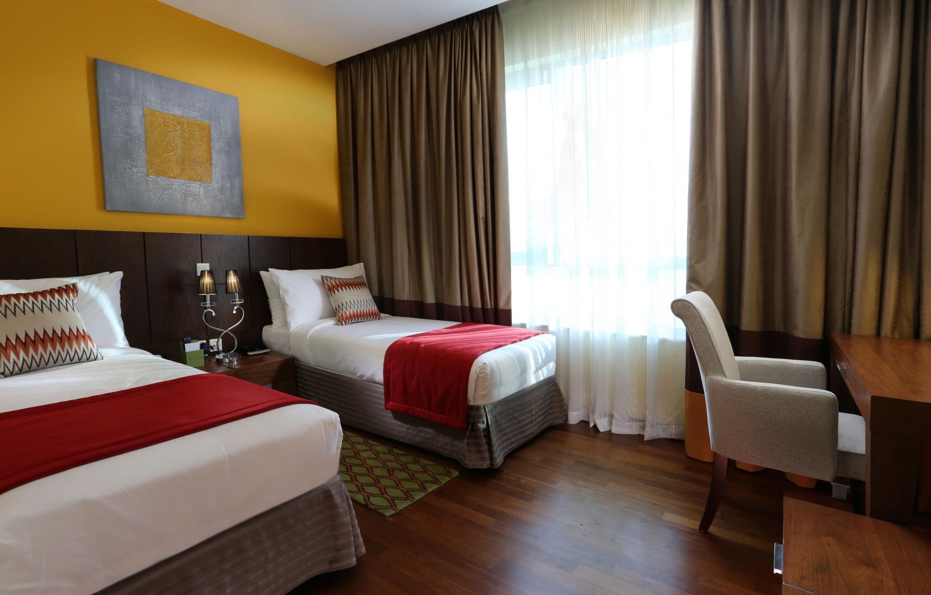 Twin beds at Ramada Downtown Dubai Apartments - Citybase Apartments
