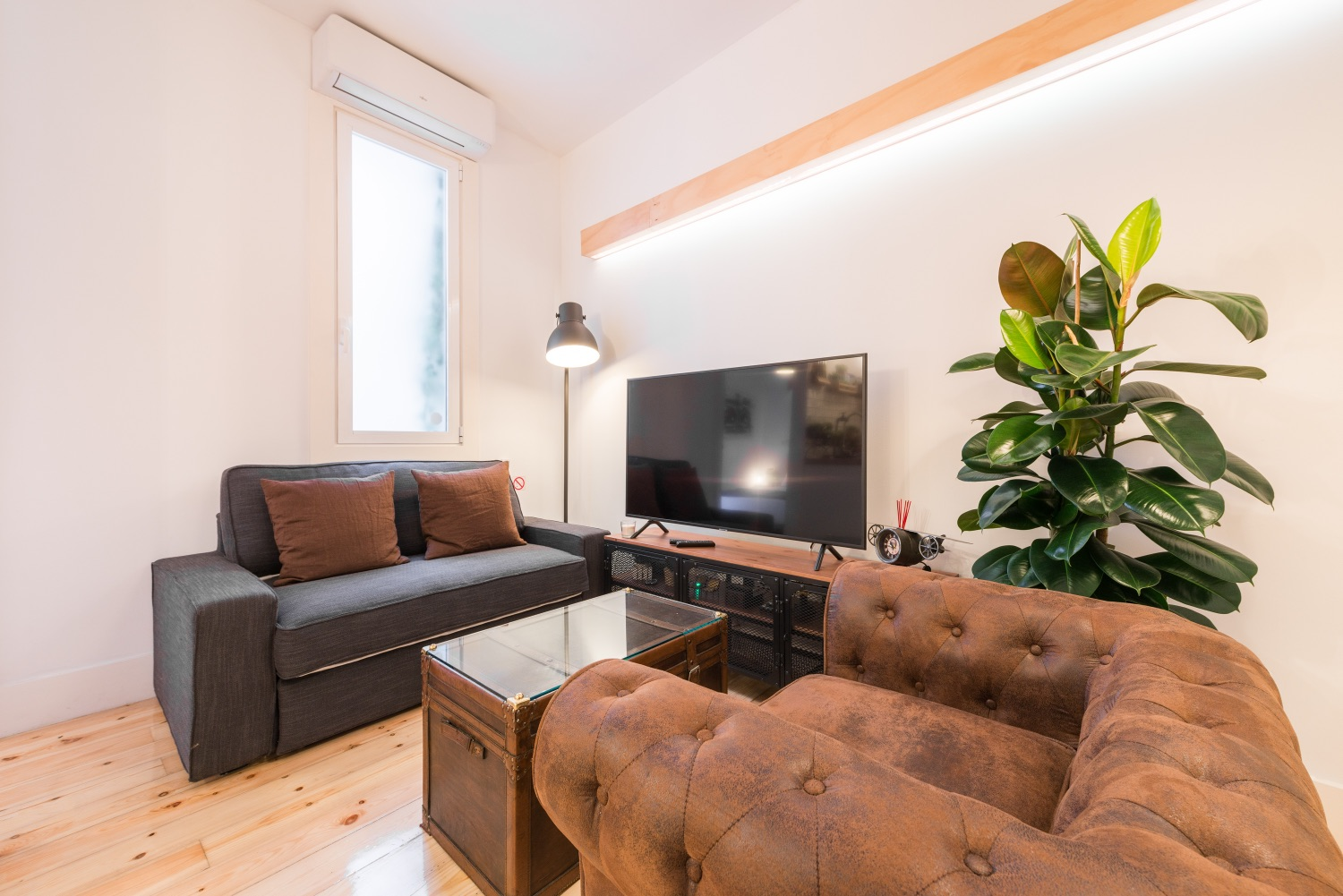 Living room at Atocha Nest Apartment - Citybase Apartments