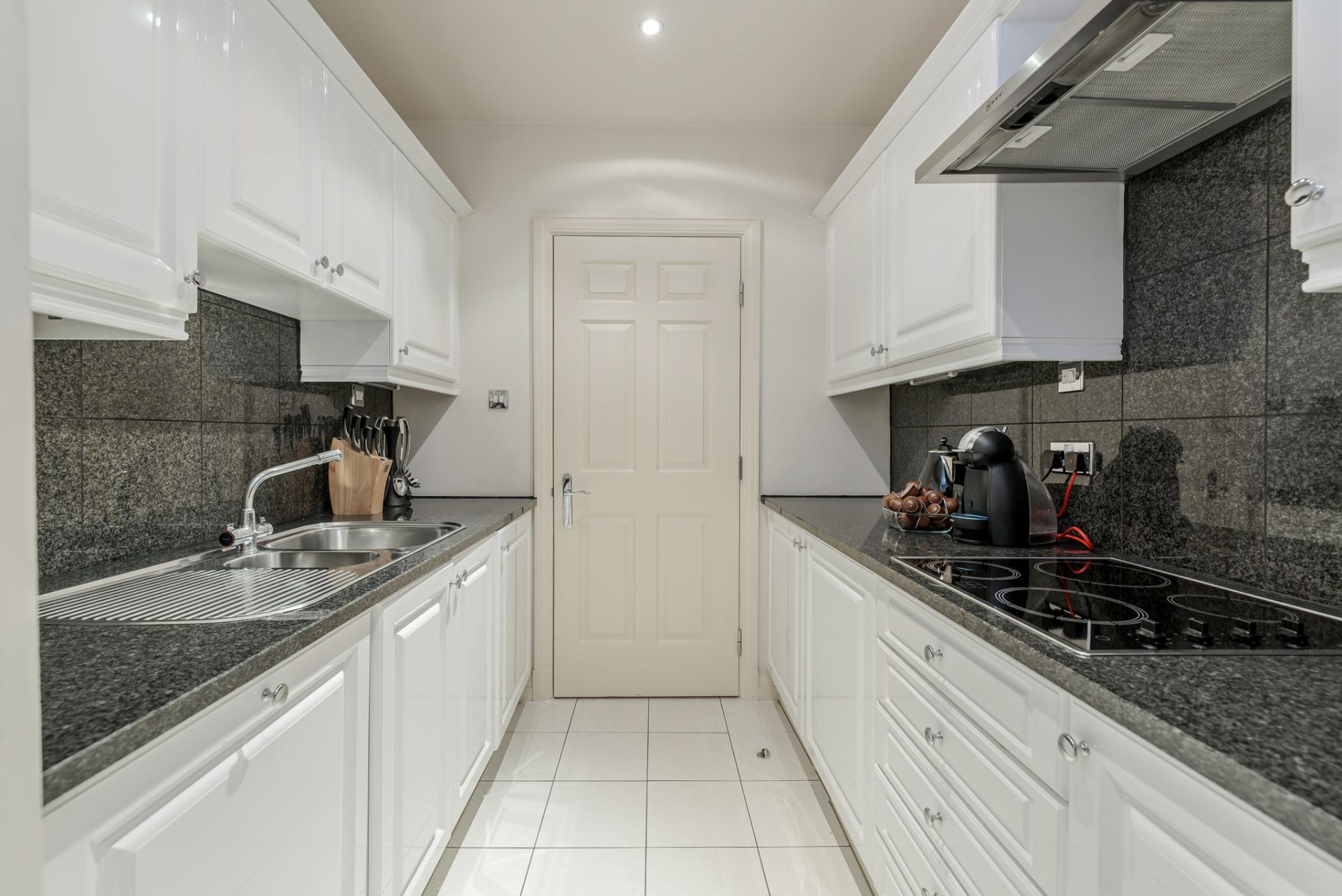 Kitchen facilities at Point West Cromwell Apartments - Citybase Apartments