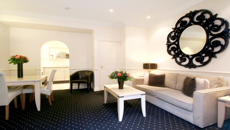 Large inviting living area at Collingham Serviced Apartments - Citybase Apartments