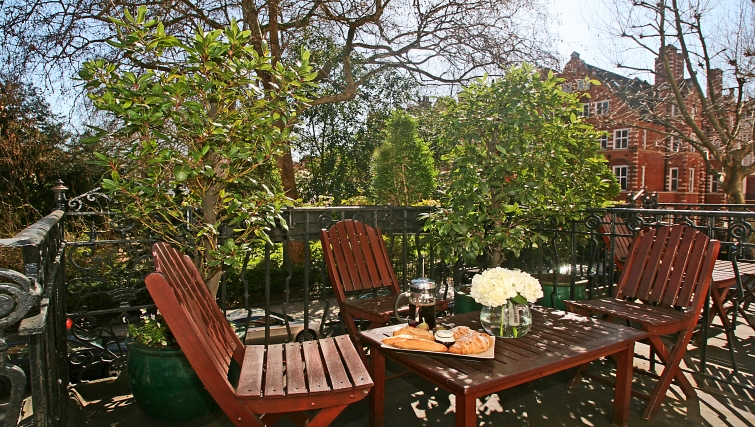 Relaxing balcony at at Collingham Serviced Apartments - Citybase Apartments