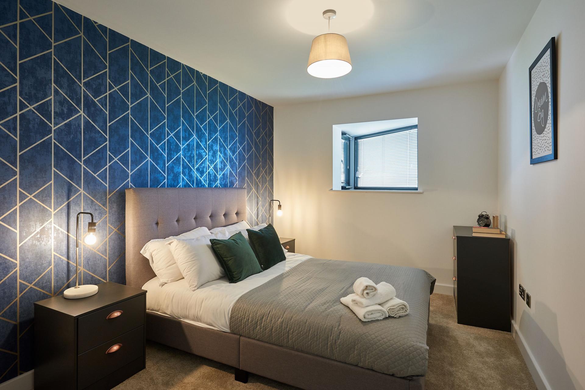 Blue bedroom at Tennant Street Apartments - Citybase Apartments