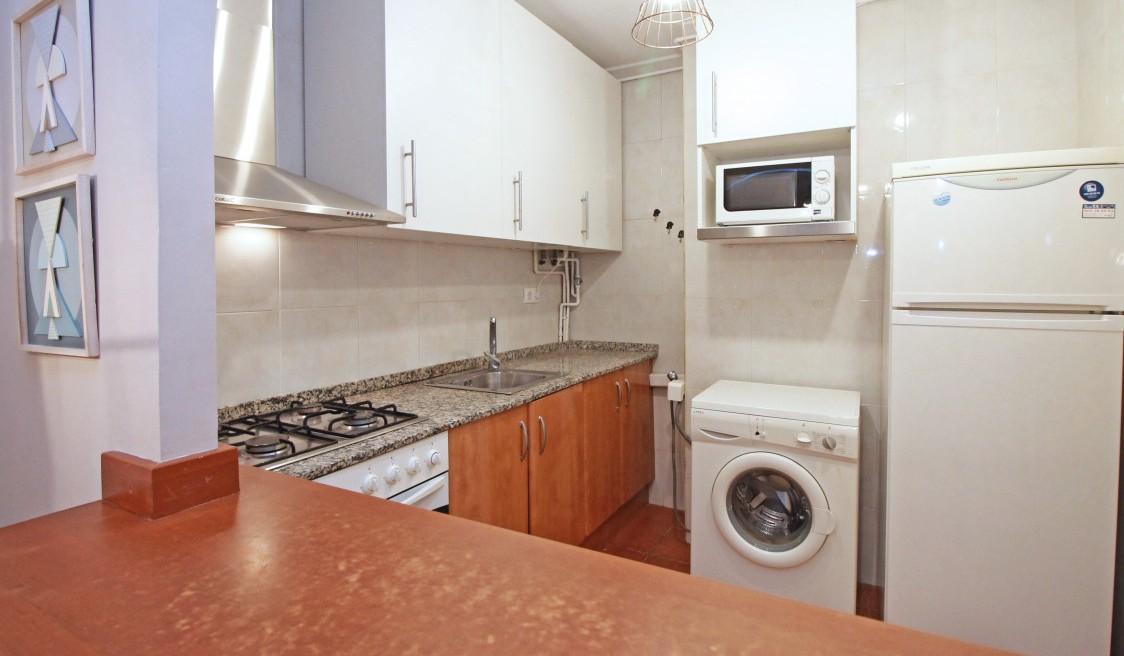 Kitchen at Travesera De Gracia Apartment - Citybase Apartments
