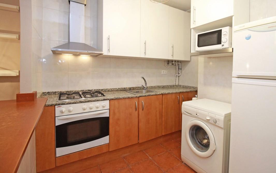 Laundry facilities at Travesera De Gracia Apartment - Citybase Apartments