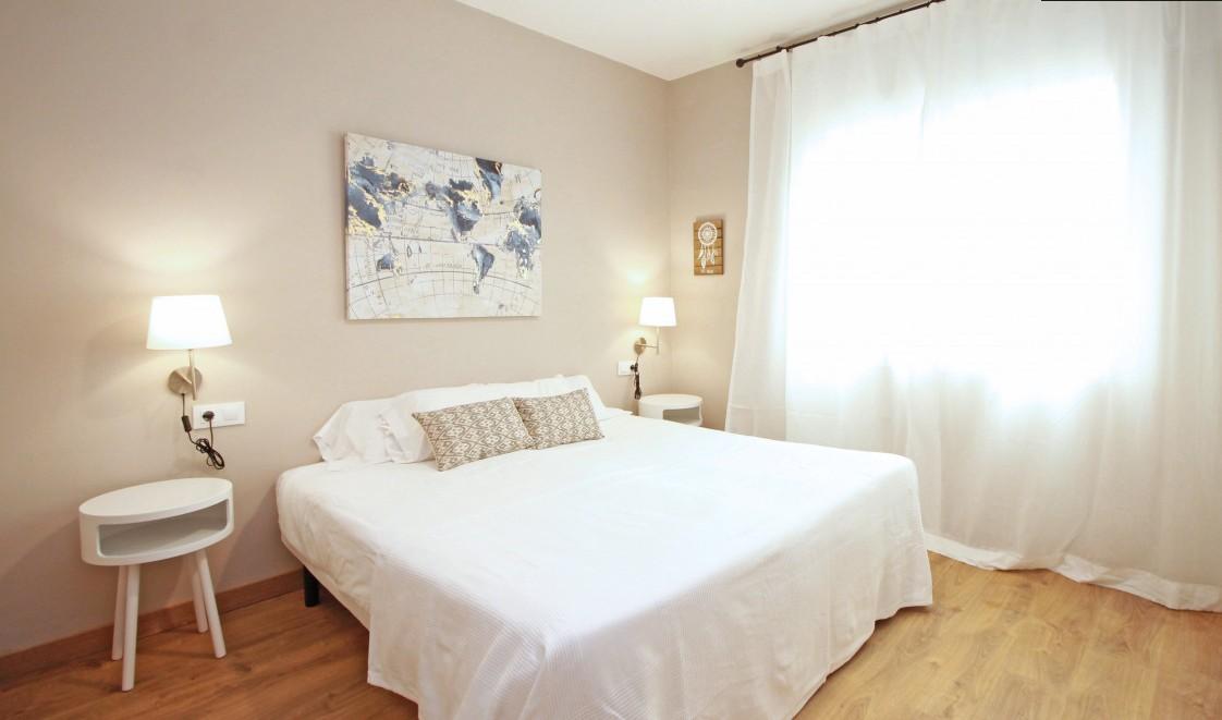 Bright bedroom at Travesera De Gracia Apartment - Citybase Apartments