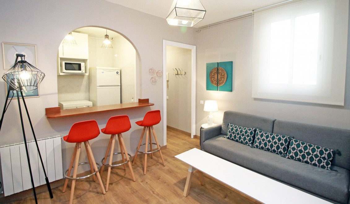 Sofa at Travesera De Gracia Apartment - Citybase Apartments