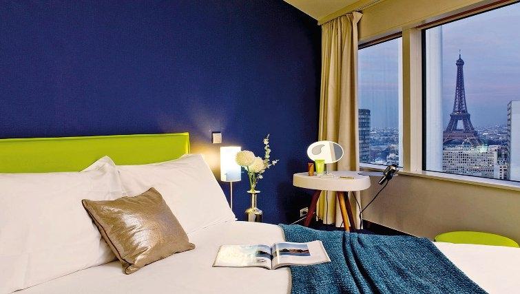 Comfortable bedroom in Adagio Paris Centre Tour Eiffel - Citybase Apartments