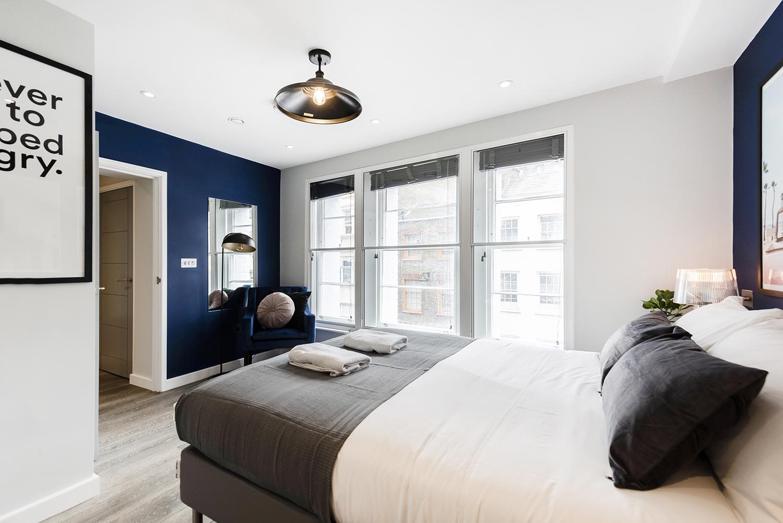 Bright bedroom at BE: Wardour Street Apartments, Soho, London - Citybase Apartments