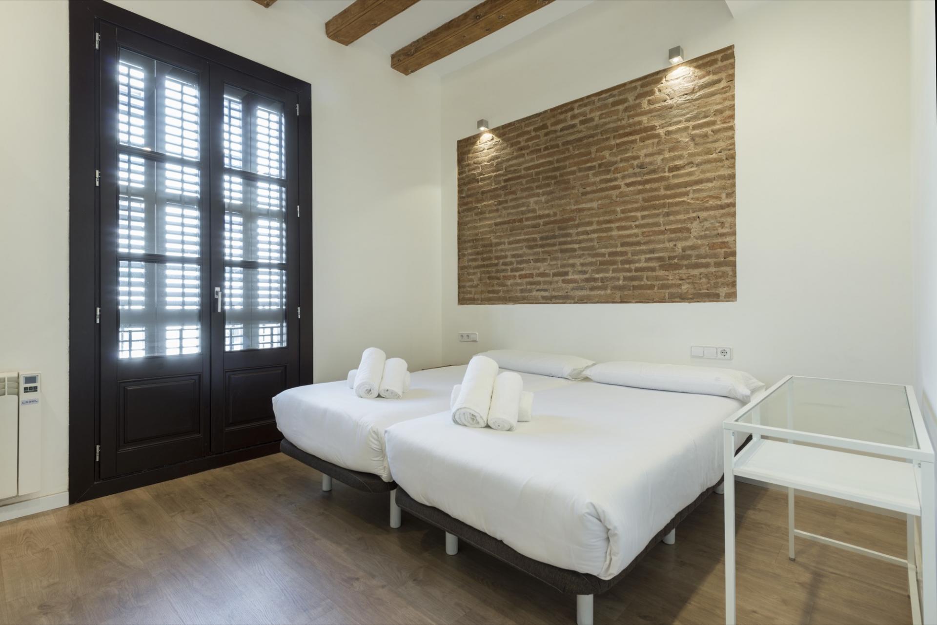 Bed at Pelayo Suites, El Raval, Barcelona - Citybase Apartments