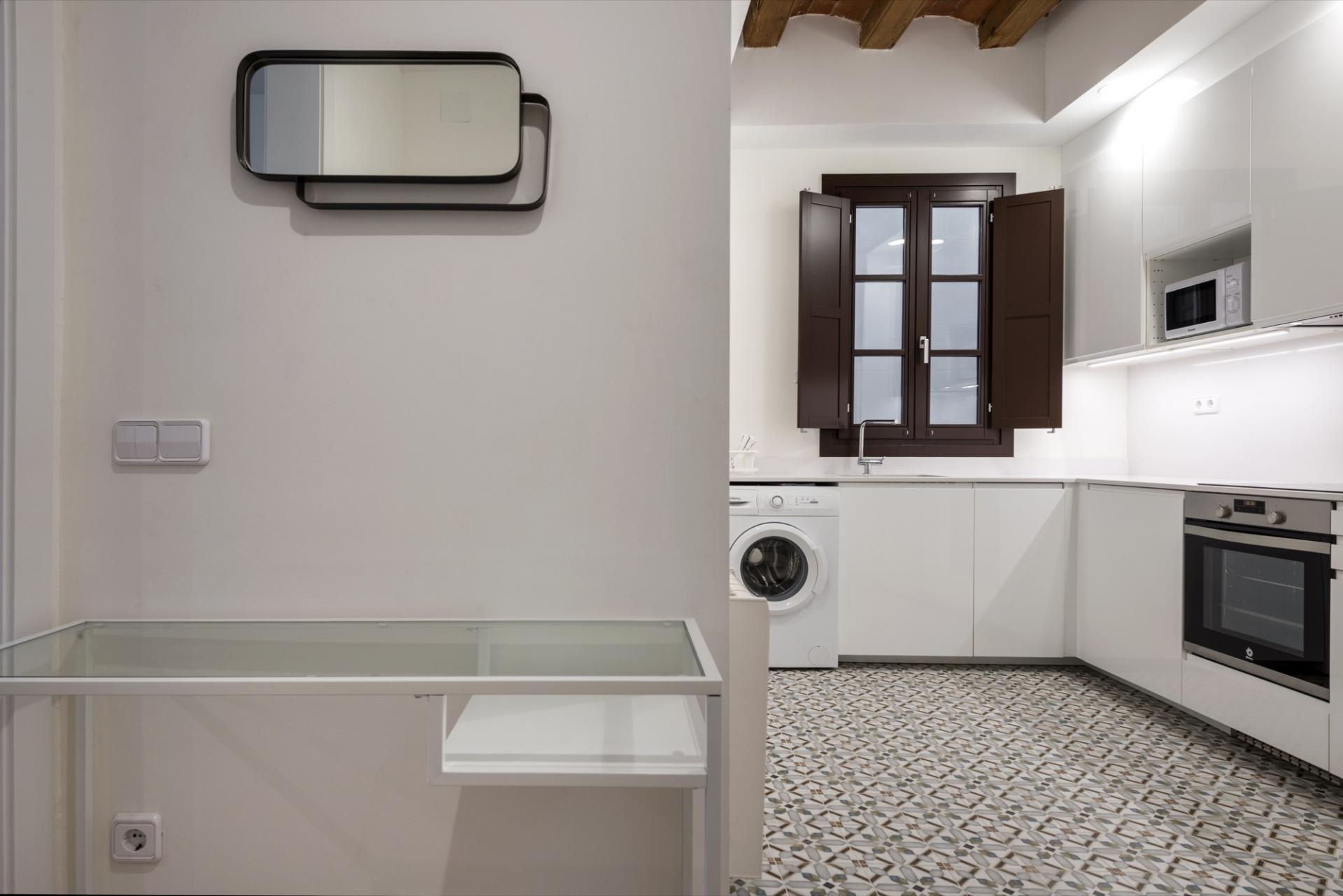 Washing machine at Pelayo Suites, El Raval, Barcelona - Citybase Apartments