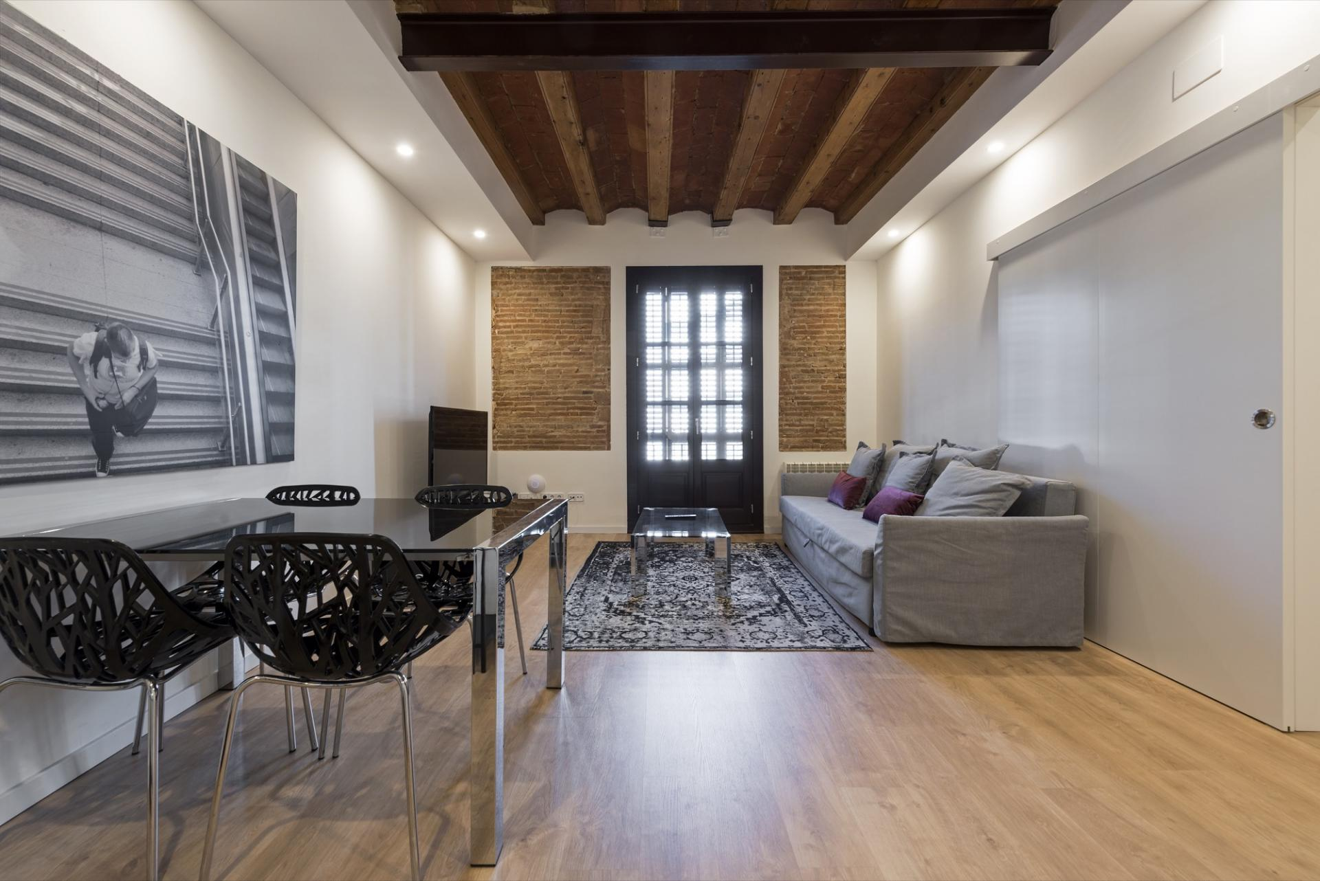 Living room at Pelayo Suites, El Raval, Barcelona - Citybase Apartments