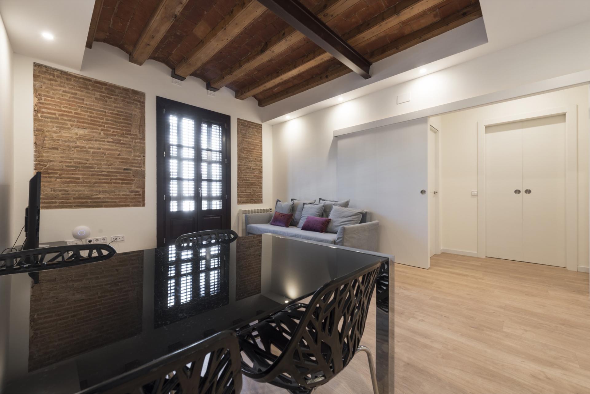 Brown window panes at Pelayo Suites, El Raval, Barcelona - Citybase Apartments