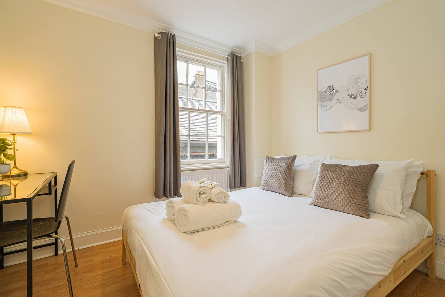 Bright bedroom at Grassmarket Apartment - Citybase Apartments