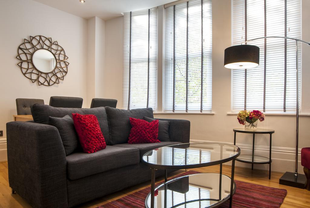 Sofa at Garrick Mansions Apartments - Citybase Apartments