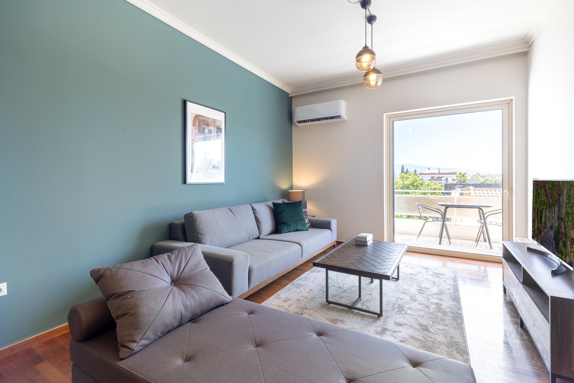 Living area at Acharnon Apartment - Citybase Apartments