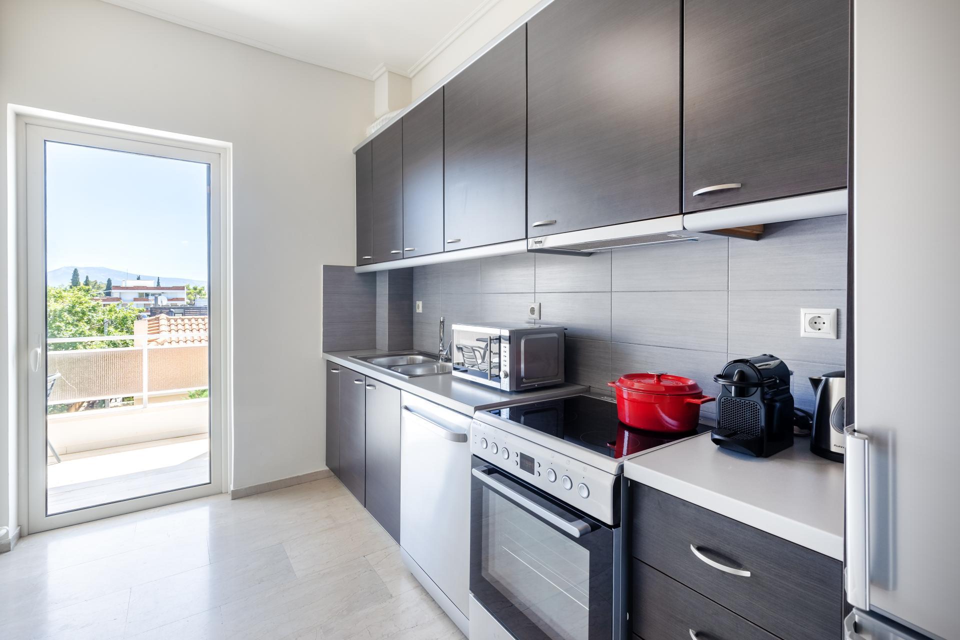 Kitchen at Acharnon Apartment - Citybase Apartments
