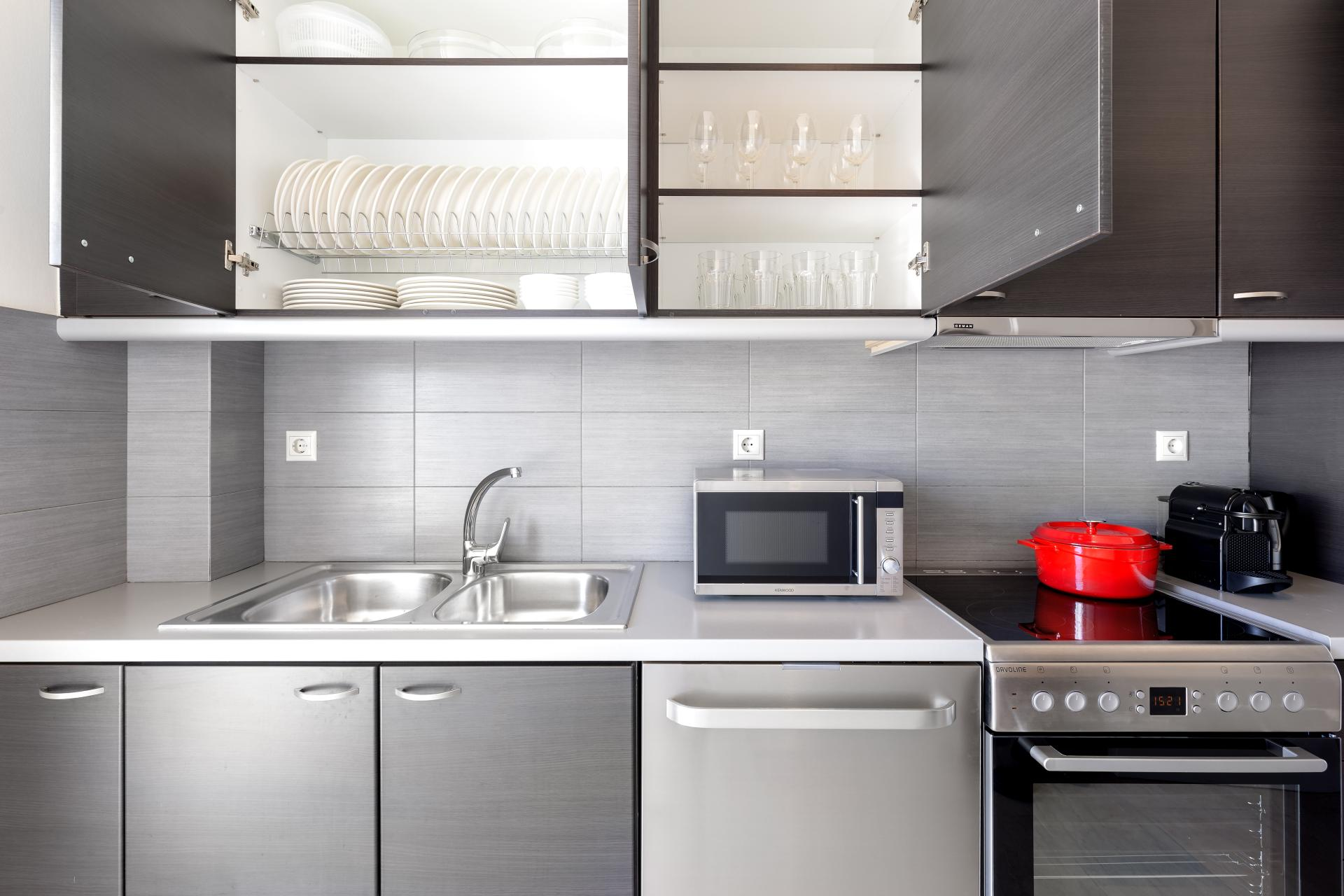 Fully equipped kitchen at Acharnon Apartment - Citybase Apartments