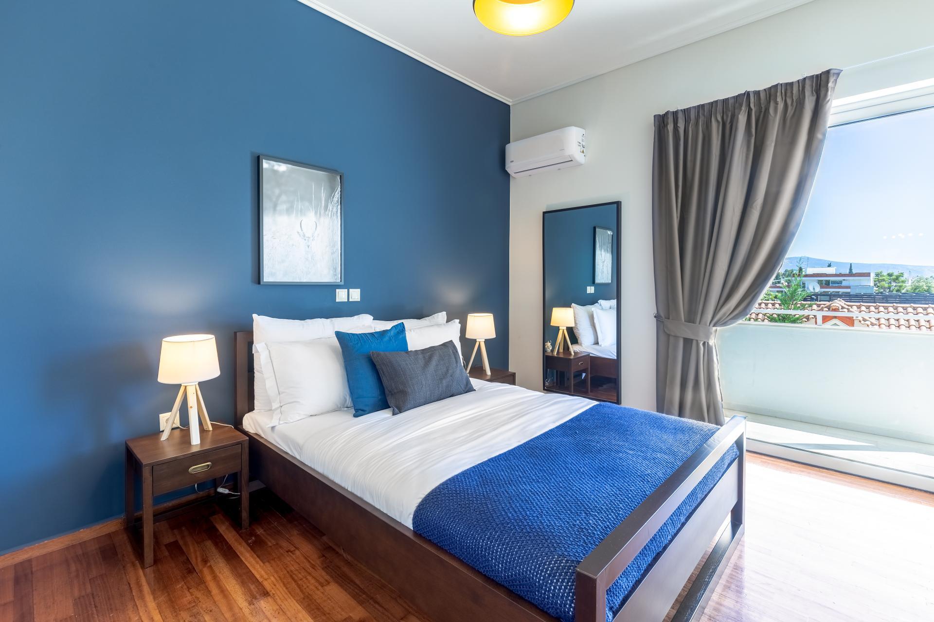 Blue room at Acharnon Apartment - Citybase Apartments