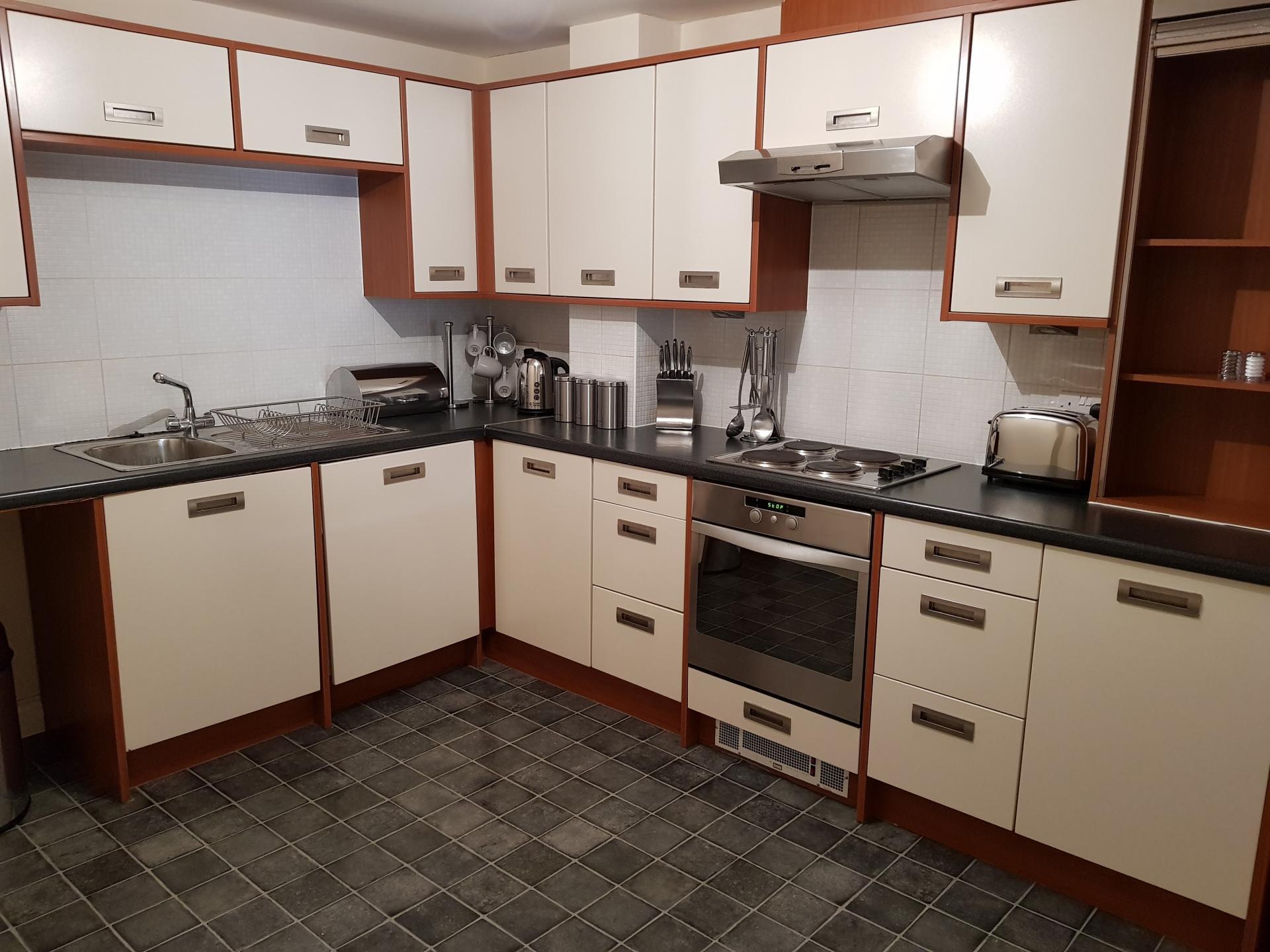 Kitchen at Le Tissier Court Apartment, The Polygon, Southampton - Citybase Apartments