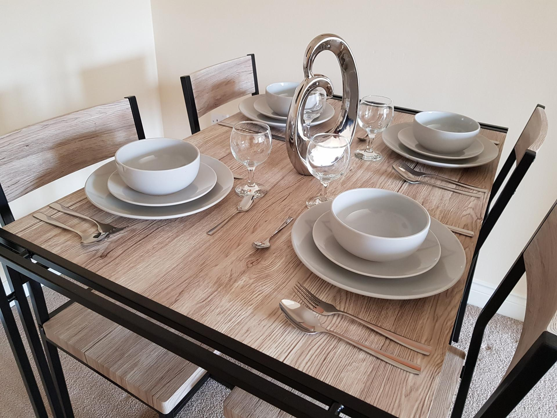 Dining table at Le Tissier Court Apartment, The Polygon, Southampton - Citybase Apartments