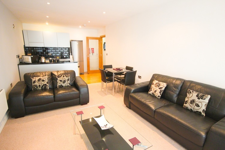 Living room at Quayside Loft Apartments - Citybase Apartments