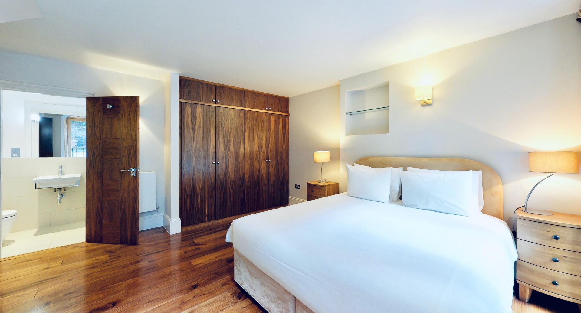 Master bedroom at Tavistock Place Apartments, Fitzrovia, London - Citybase Apartments
